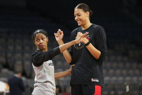 Las Vegas Aces' Sydney Colson, left, defends teammate Liz Cambage during a team practice at Man ...
