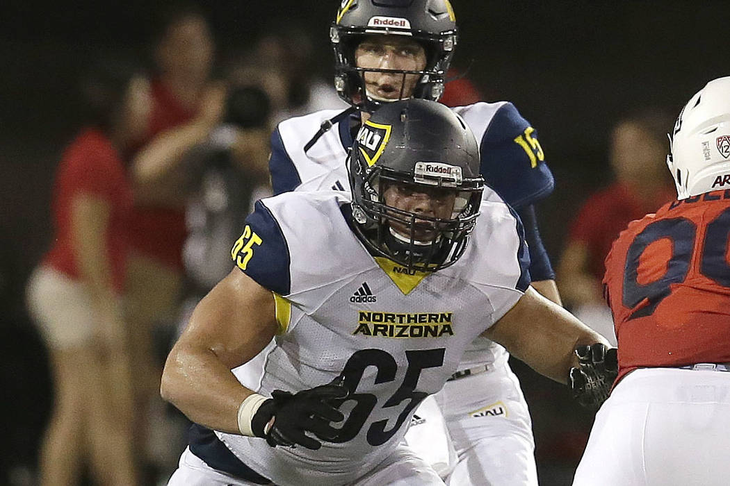 Northern Arizona offensive lineman Malik Noshi (65) in the first half during an NCAA college fo ...