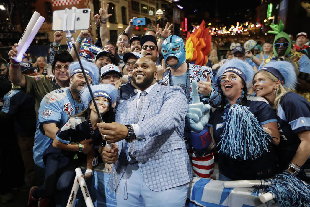 Tennessee Titans player Jurrell Casey takes a photo with fans on the main stage after announcin ...