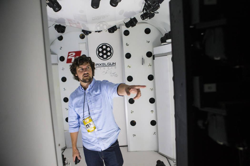 Ethan Johnson, of Pixelgun Studio, shows the multi-camera studio used to help scan NBA basketba ...