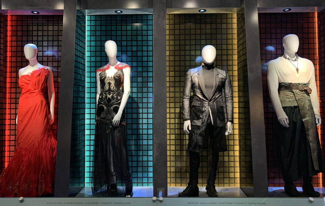 Costumes that were worn by the cast of the Hunger Games movies are on display as part of the Hu ...