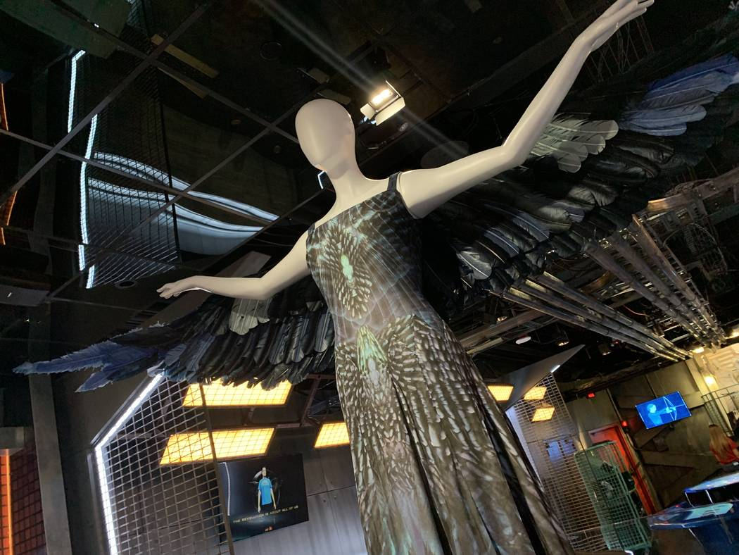 A costume worn by Jennifer Lawrence in the Hunger Games movies on display as part of the Hunger ...