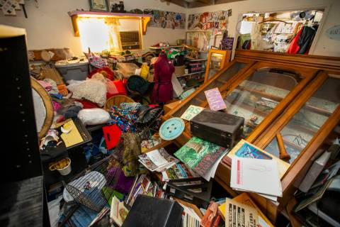 Furniture and project items are piled up in a room at Zana and Charlie Eisenhour's Pioneer Poin ...
