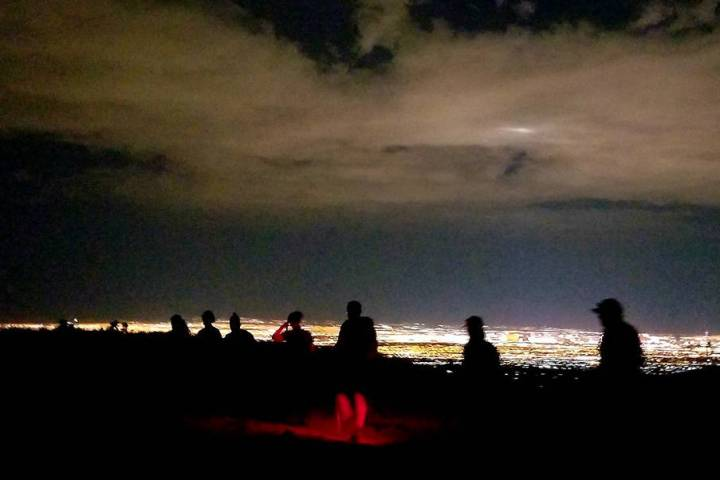 Hikers' silhouettes are seen. (Natalie Burt)