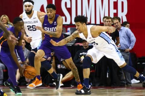Memphis Grizzlies' Brandon Clarke, right, goes for a rebound against Phoenix Suns' Jared Harper ...