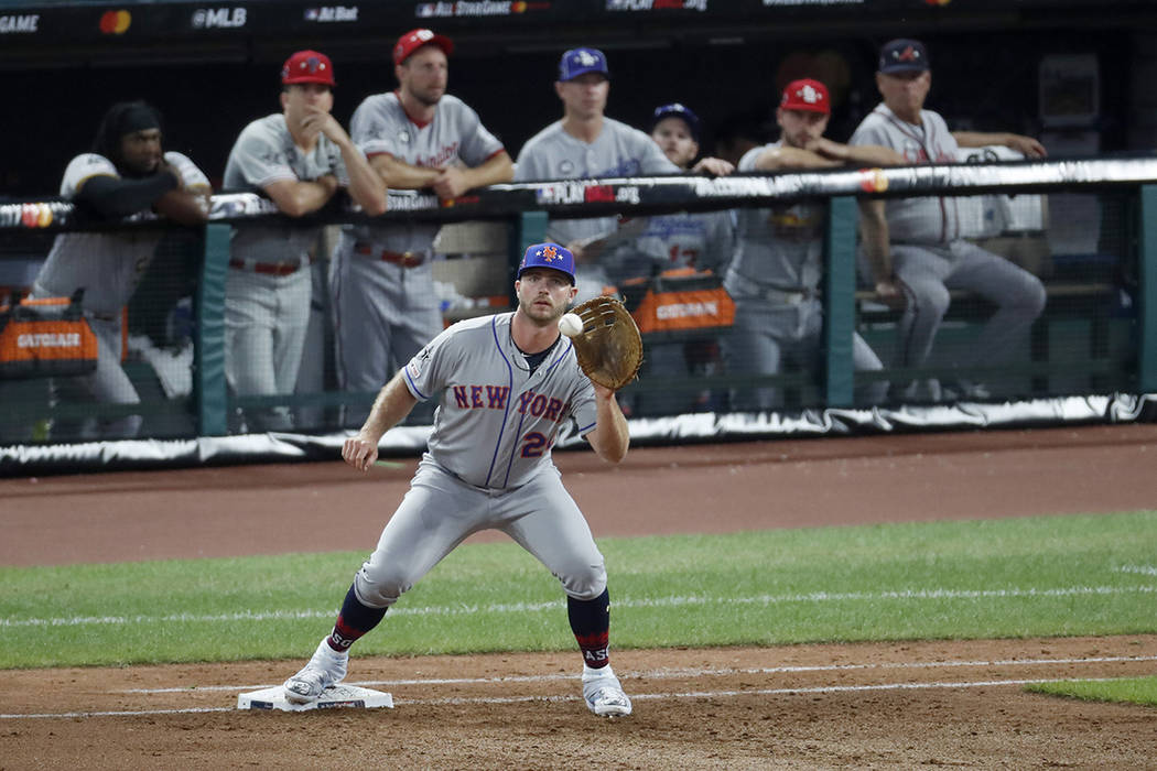National League first baseman Pete Alonso, of the New York Mets, catches a throw from National ...