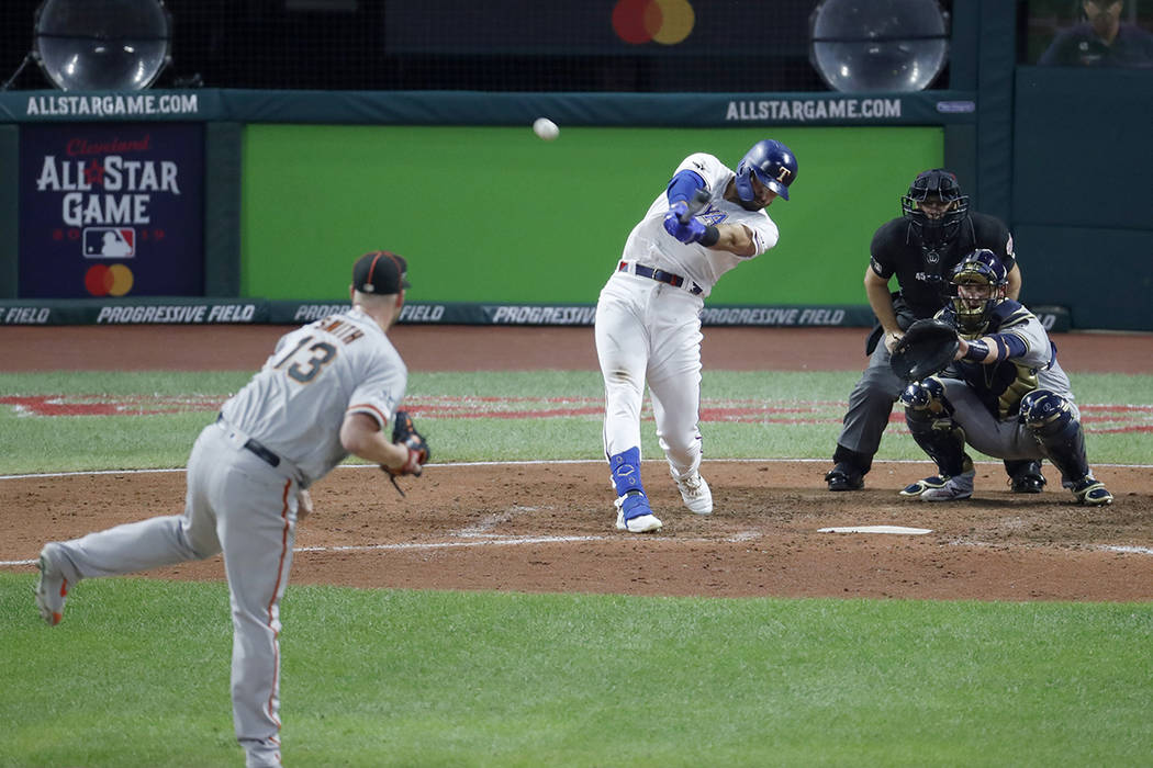 American League's Joey Gallo, of the Texas Rangers, hits a solo home run off National League pi ...
