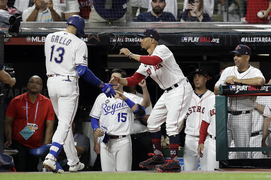 American League's Joey Gallo (13), of the Texas Rangers, is congratulated by American League te ...