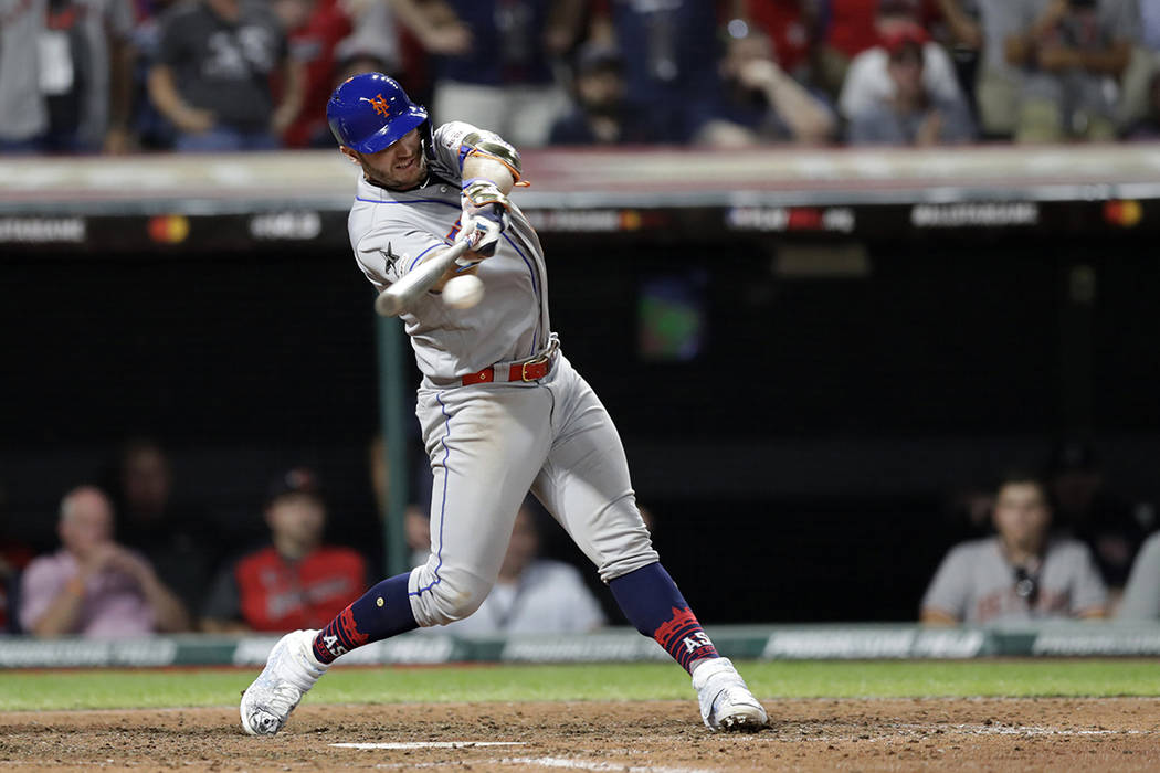 National League's Pete Alonso, of the New York Mets, hits a two run single during the eighth in ...
