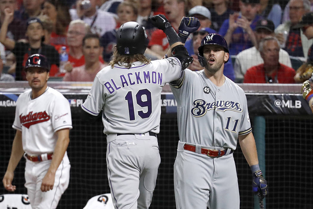 National League's Charlie Blackmon (19), of the Colorado Rockies, celebrates with National Leag ...
