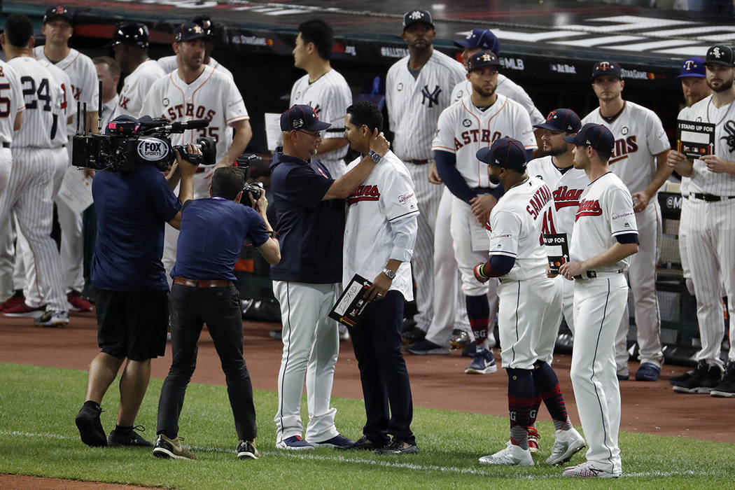 Cleveland Indians manager Terry Francona, left, hugs Indians pitcher Carlos Carrasco during the ...