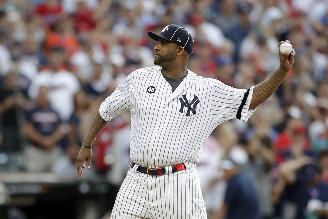 New York Yankees' CC Sabathia throws out the ceremonial first pitch before the start of the MLB ...
