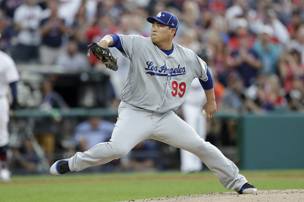 National League starting pitcher Hyun-Jin Ryu, of the Los Angeles Dodgers, throws during the fi ...