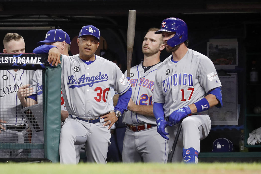 National League manager Dave Roberts (30), of the Los Angeles Dodgers, talks with National Leag ...