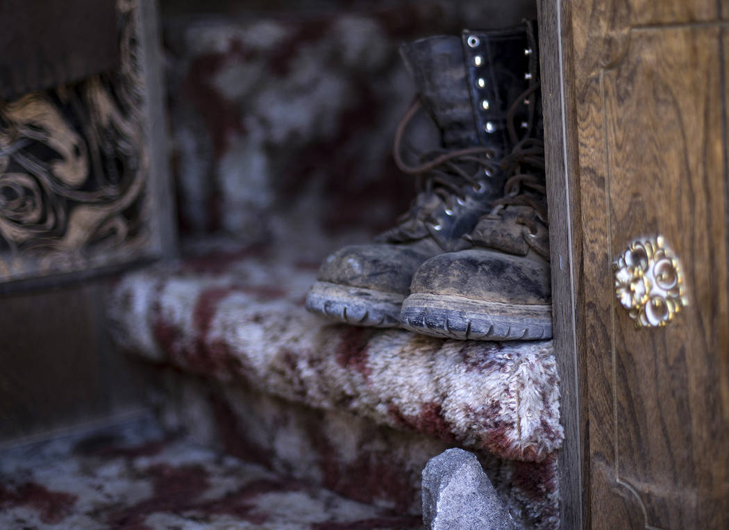 Boots in the trailer on the property where Troy Ray died as a result of the July 4 earthquake w ...