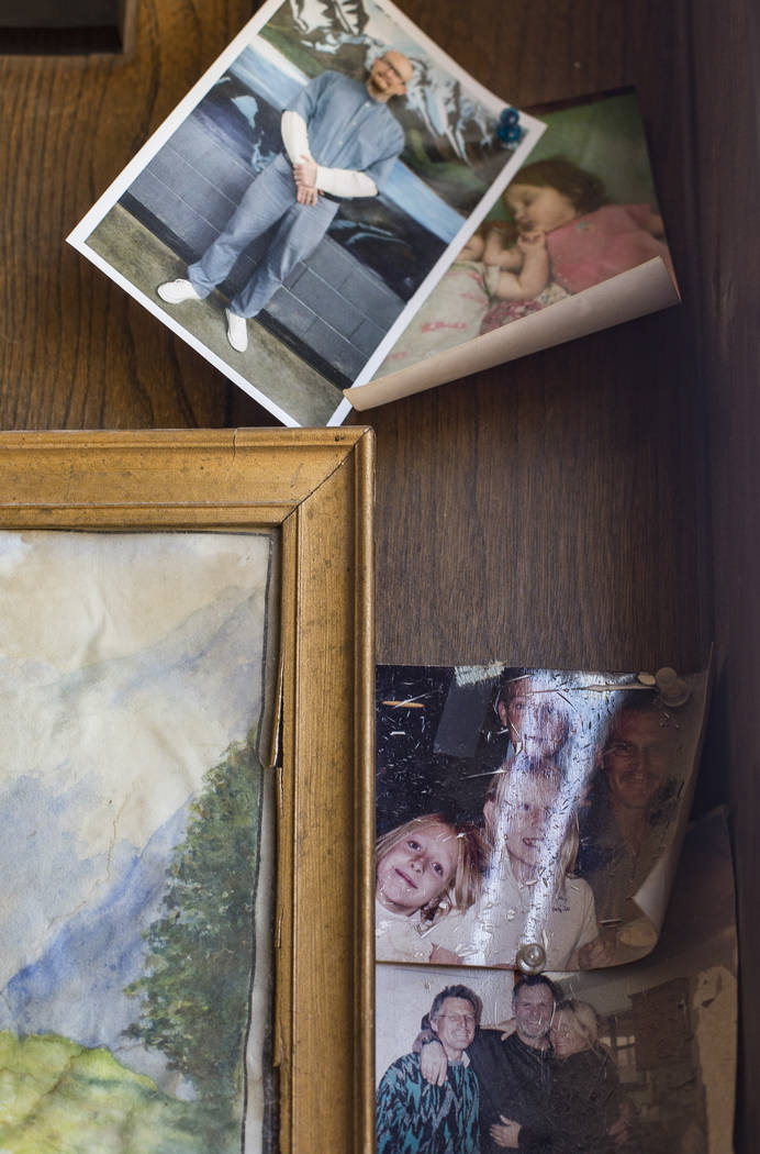Photos tacked on the trailer wall on the property where Troy Ray died as a result of the July 4 ...