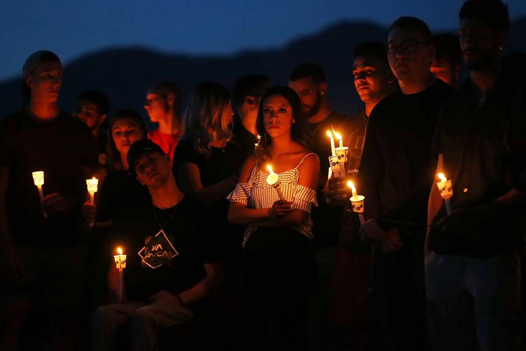 Over one hundred friends and family of Malik Noshi gather at Arbor View High School for a vigil ...