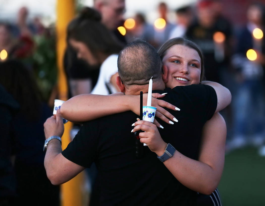 Kaelyn Moore, right, greets attendees during a vigil for Malik Noshi, a former Arbor View High ...
