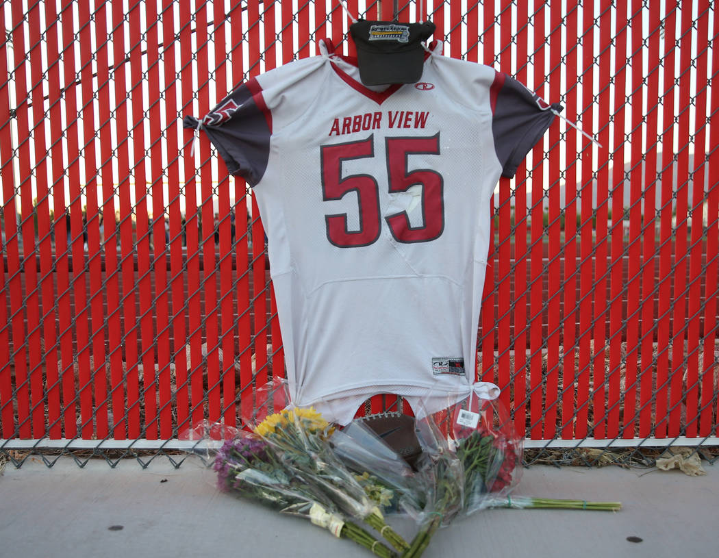 A memorial outside the Arbor View High School football field during a vigil for Malik Noshi, a ...