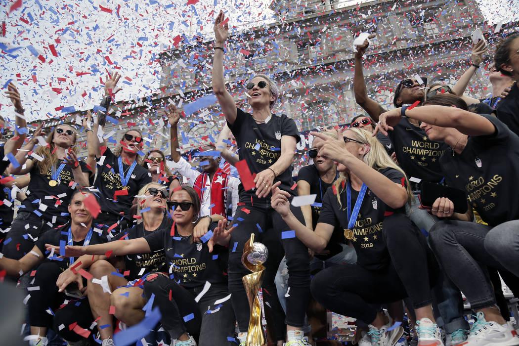 The U.S. women's soccer team, Megan Rapinoe center, celebrates at City Hall after a ticker tape ...