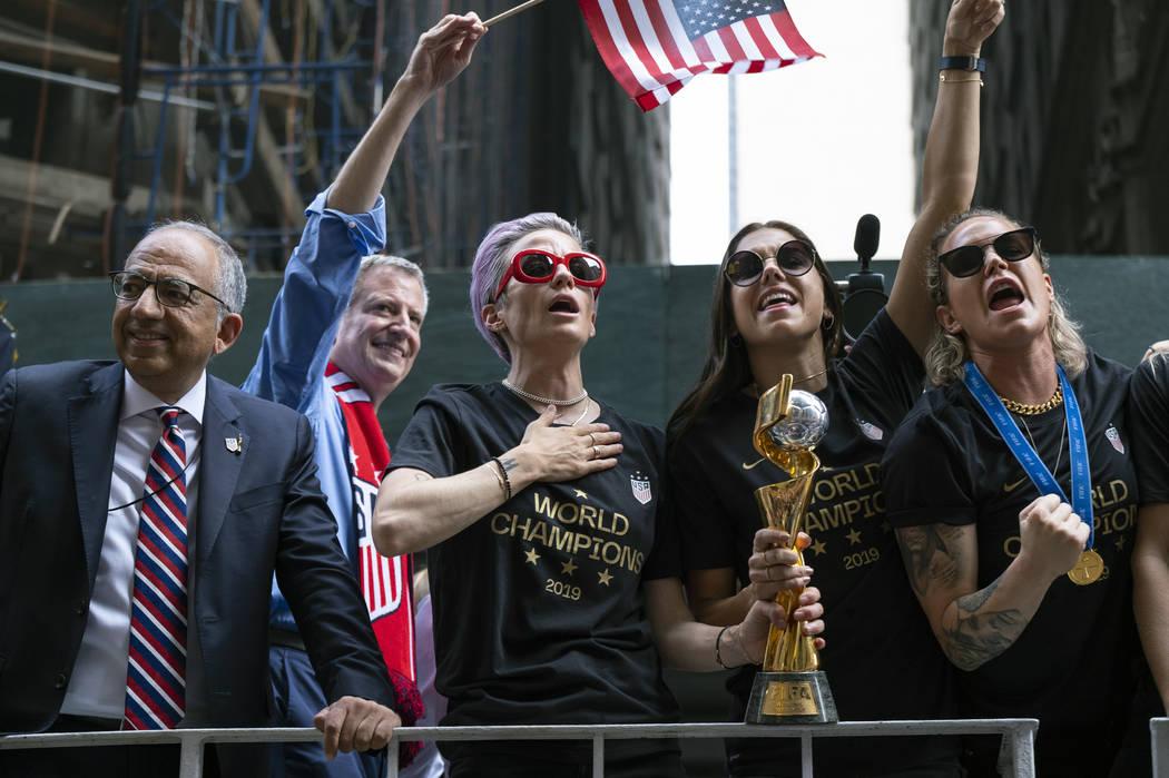 From left, U.S. Soccer Federation President Carlos Cordeiro, New York Mayor Bill de Blasio and ...