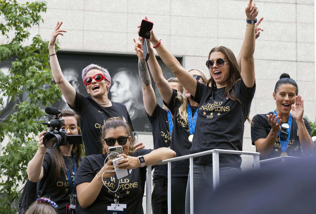 Members of the U.S. women's soccer team, including Megan Rapinoe, rear left, and Alex Morgan, r ...