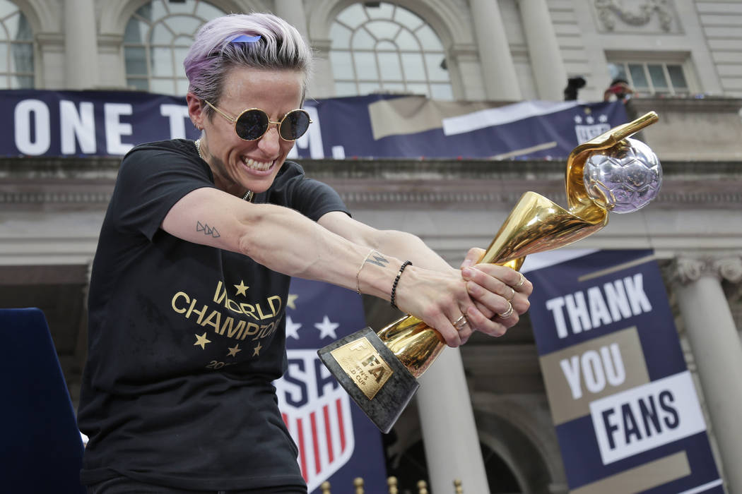 U.S. women's soccer player Megan Rapinoe celebrates with the FIFA Women's World Cup trophy at C ...