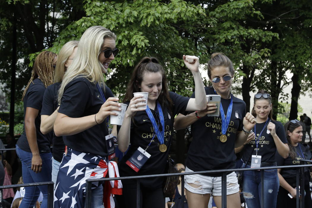 U.S. women's soccer team player Rose Lavelle, center, gestures while standing with teammates on ...