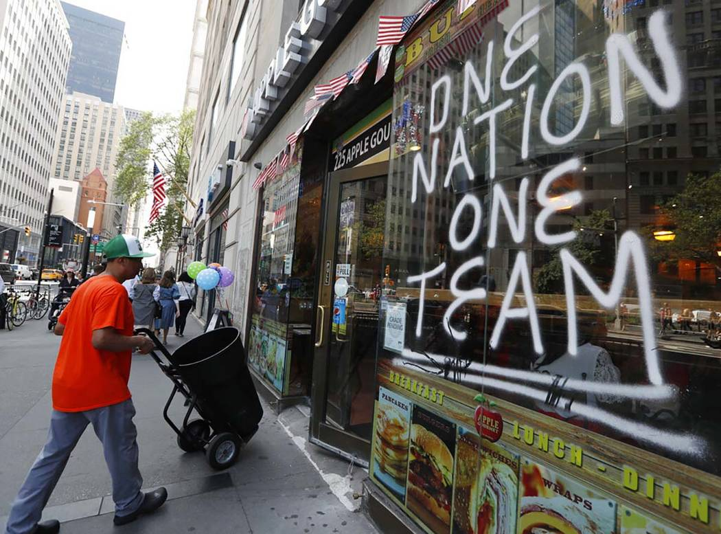 A spray-painted sign honors the four-time World Cup winning U.S. women's soccer team, one day a ...