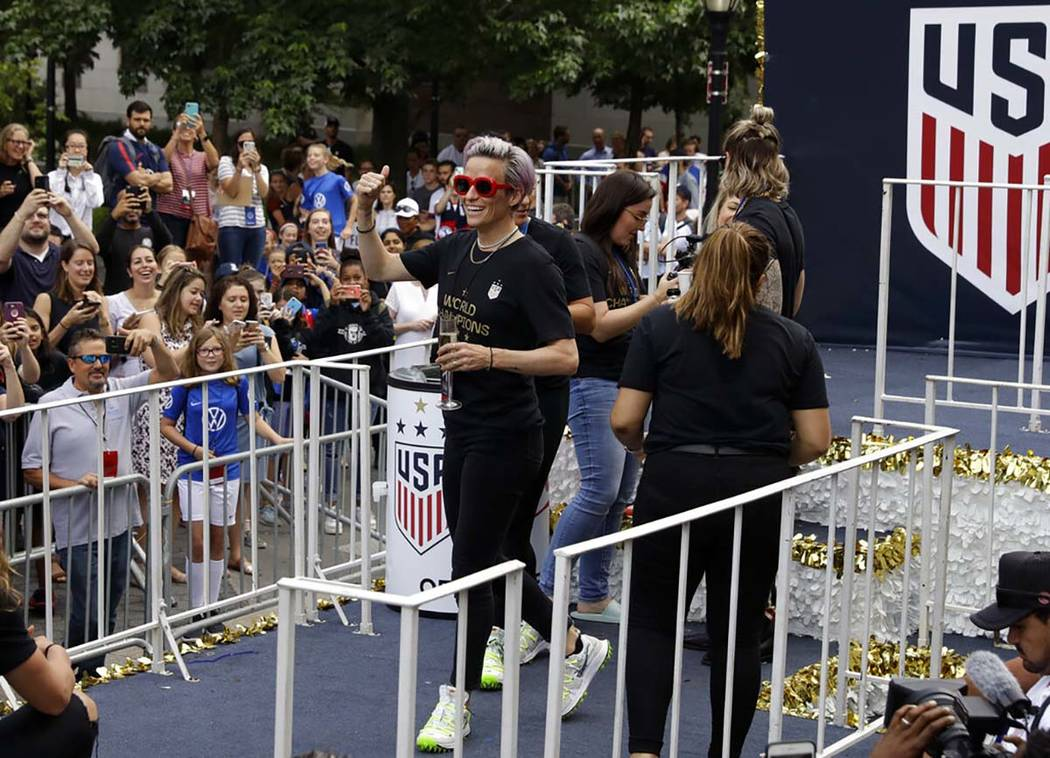 Megan Rapinoe with the U.S. women's soccer team walks onto a float before the start of t ...