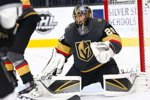 Golden Knights goaltender Marc-Andre Fleury (29) defends the net during an NHL hockey game agai ...