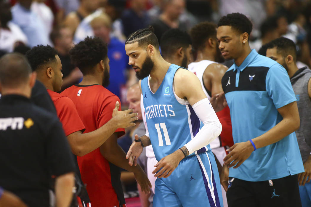 Charlotte Hornets' Cody Martin (11) shakes hands after playing against the Chicago Bulls at the ...