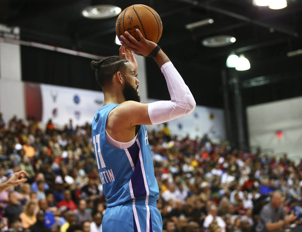 Charlotte Hornets' Cody Martin (11) looks to throw the ball in during the second half of a bask ...