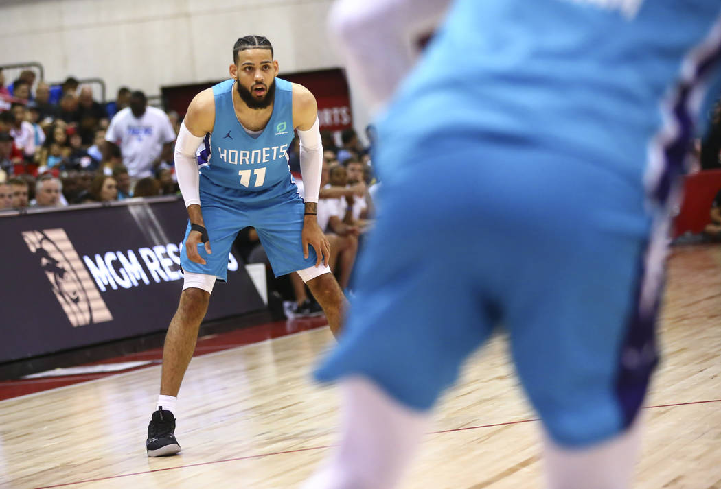 Charlotte Hornets' Cody Martin (11) looks on during the second half of a basketball game agains ...