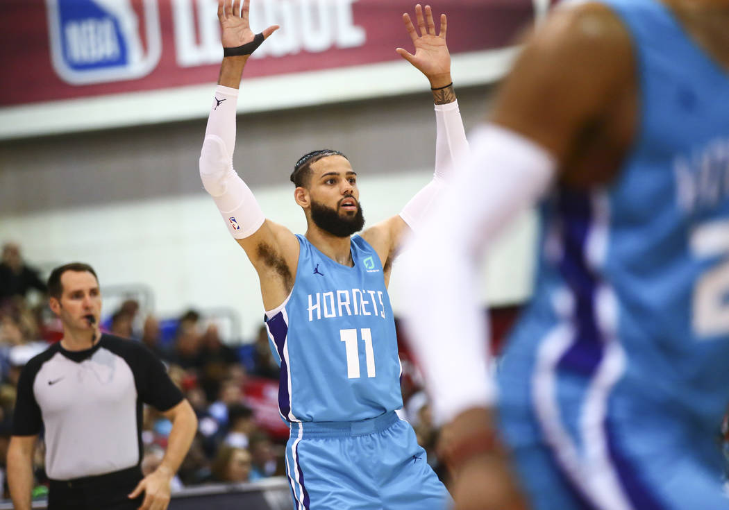 Charlotte Hornets' Cody Martin (11) motions to teammates during the second half of a basketball ...