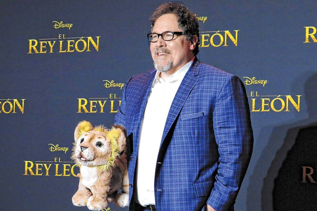 "Director Jon Favreau poses during a news conference to promote his film, ""The Lion King"" on Jun ..."