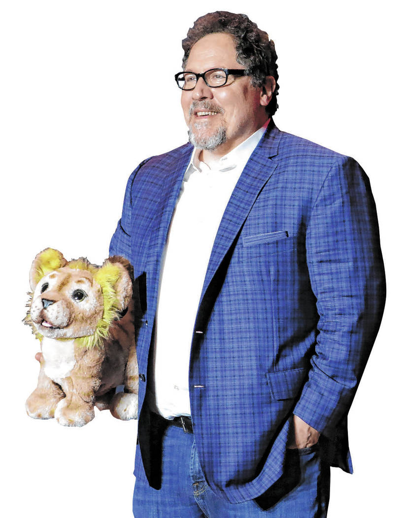"Director Jon Favreau poses during a press conference to promote his film, ""The Lion King&q ..."