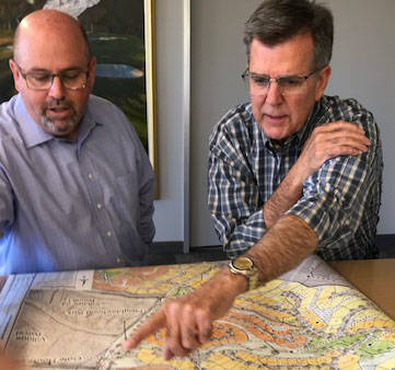 Howard Hughes Corp. executives Andy Ciarrocchi, left, and Tom Warden view map of properties bei ...