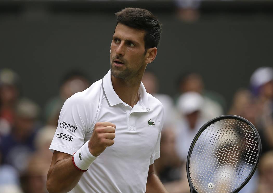 Serbia's Novak Djokovic celebrates winning the second set against Belgium's David Goffin during ...