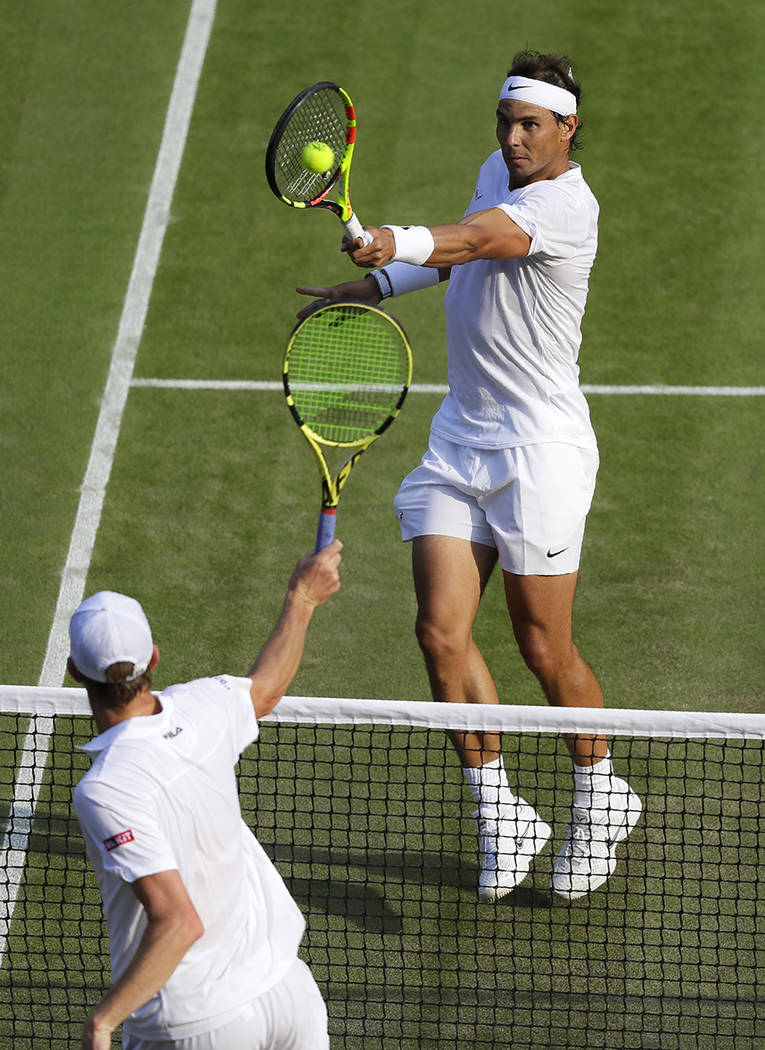 Spain's Rafael Nadal returns the ball during a men's quarterfinal match against United States' ...