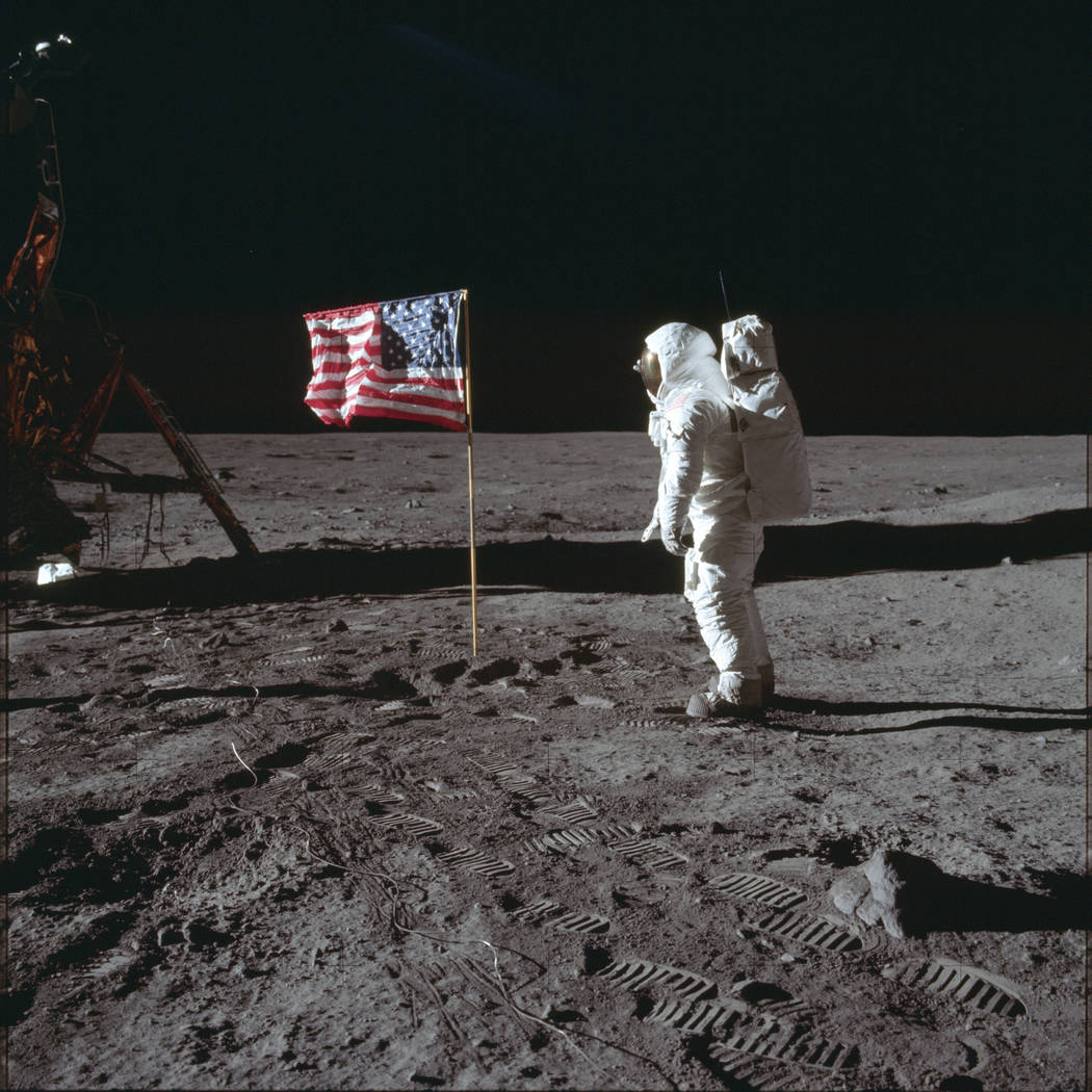 Astronaut Buzz Aldrin Jr. poses for a photograph beside the U.S. flag on the moon during the Ap ...