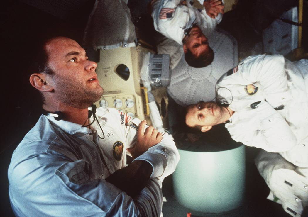 Tom Hanks, left, Kevin Bacon, center, and Bill Paxton appear in character in Universal Pictures ...
