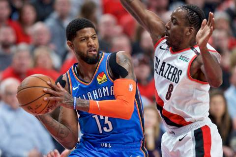 In this April 16, 2019, file photo, Oklahoma City Thunder forward Paul George, left, looks to p ...