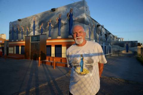 "James Stanford with part of his mural, ""A Phalanx of Angels Ascending"" on the 705 Building at 7 ..."