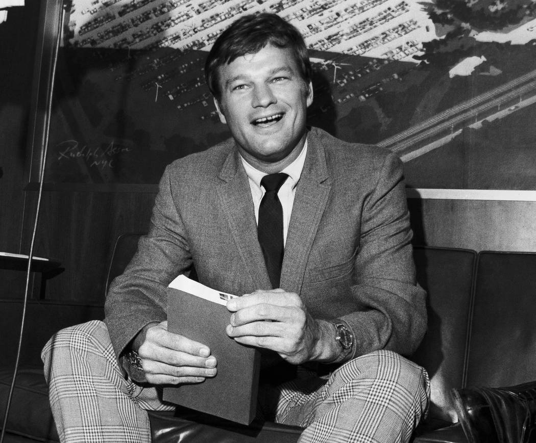 FILE - In this Aug. 11, 1970 file photo, New York Yankees pitcher Jim Bouton, holds a copy of h ...