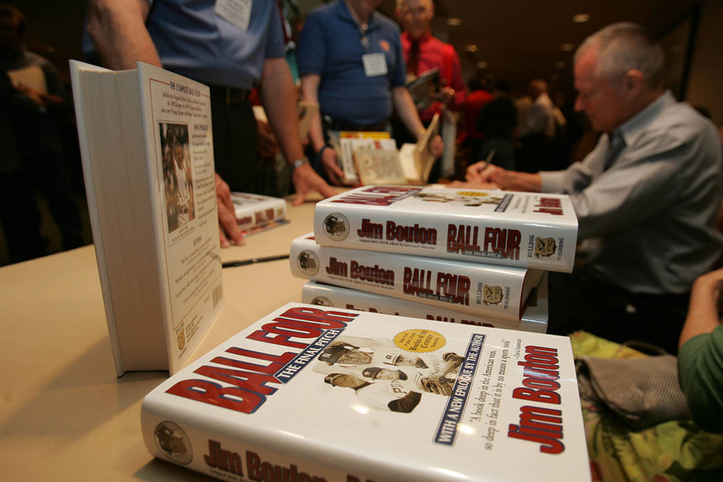 "Author Jim Bouton signs his book ""Ball Four,"" at the Society for American Baseball R ..."