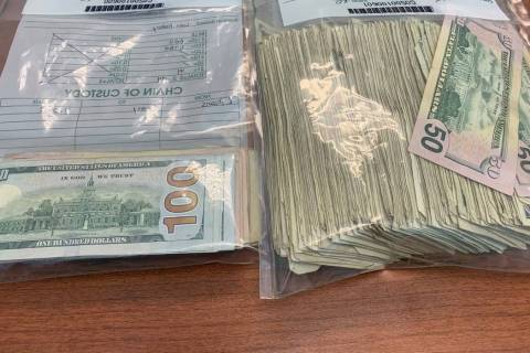 Some of the money returned to Dunwoody, Georgia, police after the cash flew out an armored truc ...