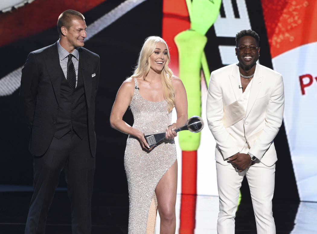 Rob Gronkowski, from left, Lindsey Vonn, and Dwyane Wade accept their awards for best moment at ...