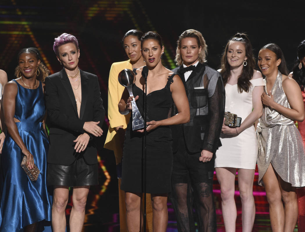 Carli Lloyd, center, and members of the U.S. women's national soccer team accept the award for ...
