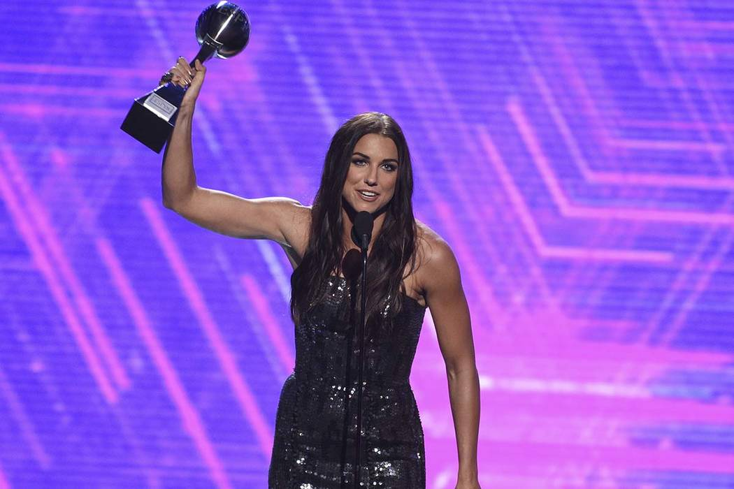Alex Morgan, a member of the U.S women's national soccer team, accepts the award for best femal ...